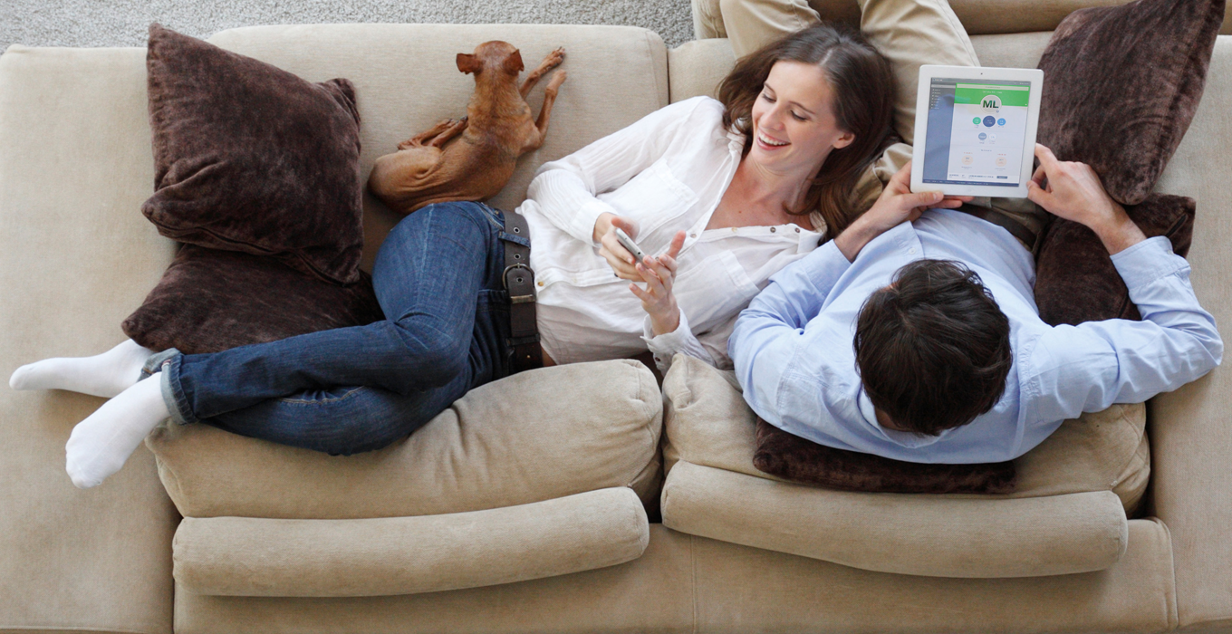 Couple at home with Mobile Link app